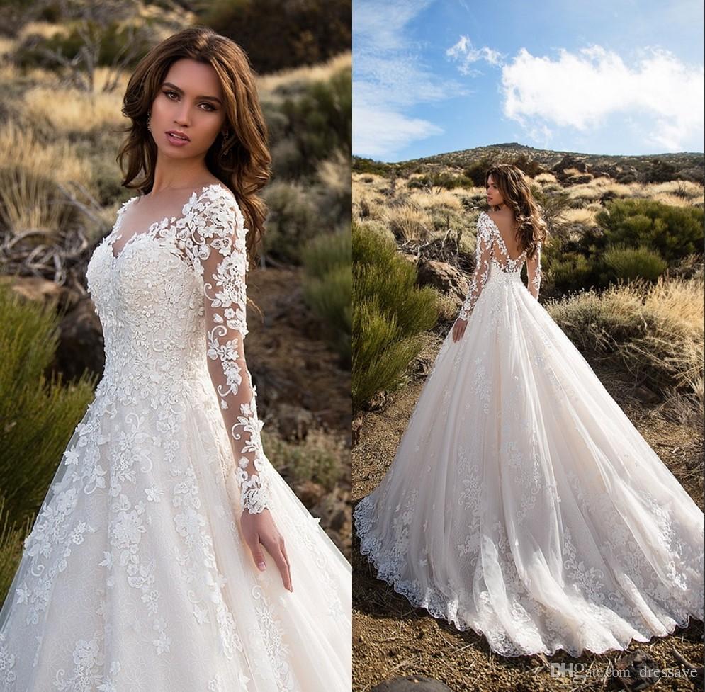 ivory long sleeved wedding dresses photo - 1