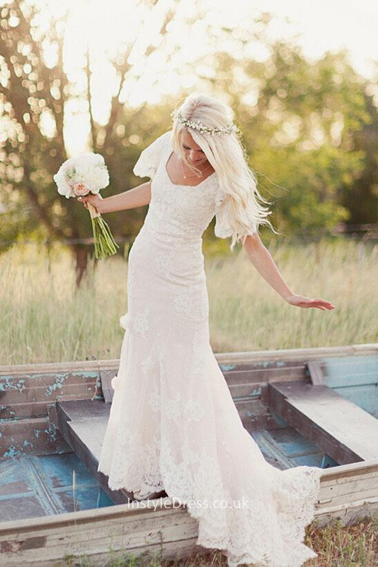 wedding dresses with flutter sleeves photo - 1