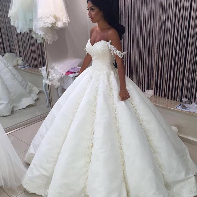 huge ball gown wedding dresses with crystals photo - 1