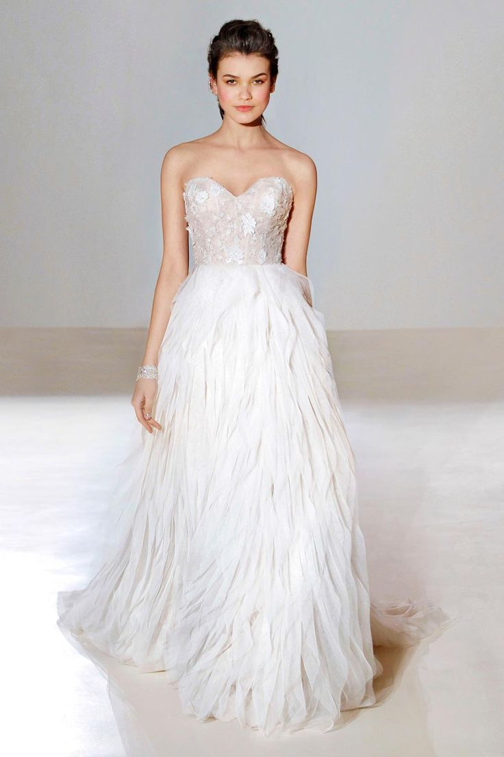 wedding dresses with feathers at the bottom photo - 1